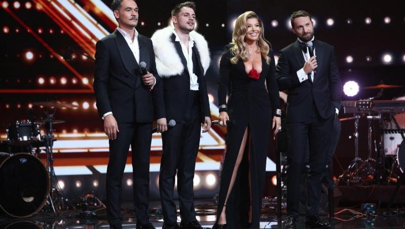 Loredana Groza, într-o rochie neagră, lungă, cu crăpătură și decoleteu, alături de Adrian Petrache și Răzvan și Dani