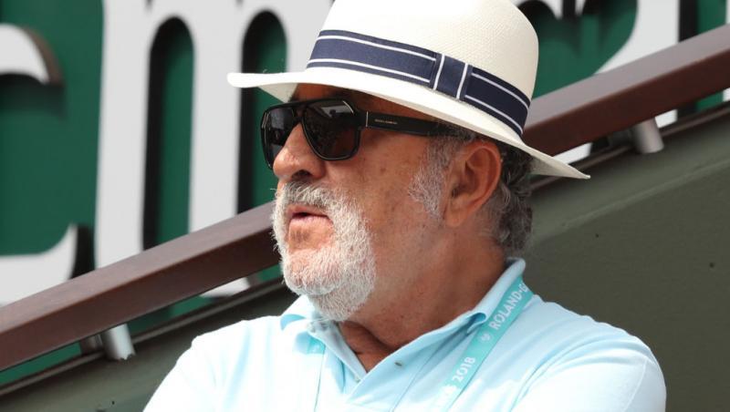 Ion Țiriac, cu o pălărie și ochelari d esoare