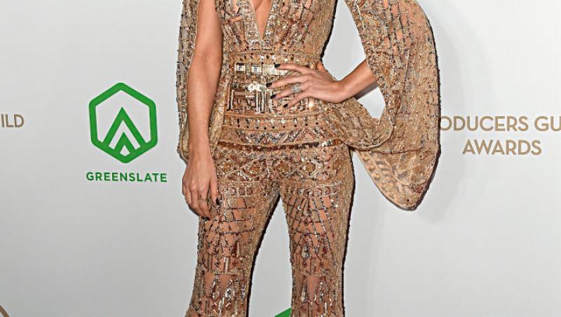 Kate Beckinsale, într-o ținută aurie, pantaloni și bluză