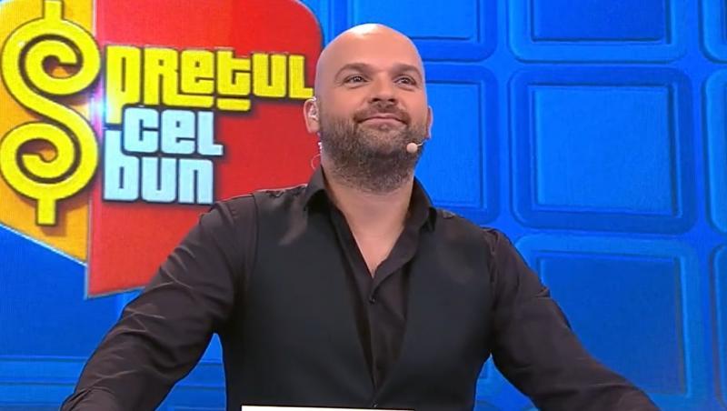 Andrei Ștefănescu în cămașă neagră și vestă neagră