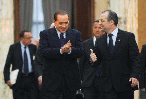 Berlusconi i-a dat lui Oprescu un set de cravate, la o cafea