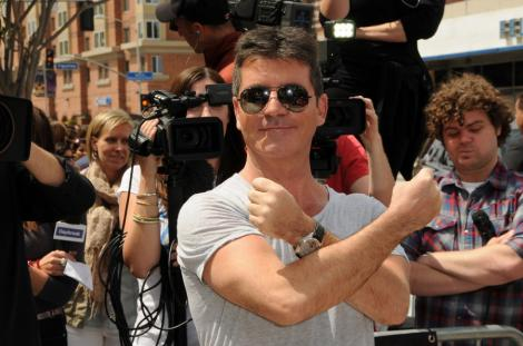 Simon Cowell castiga 75 de milioane de dolari la X Factor!