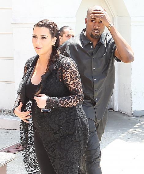 Kanye West a cumparat masini blindate pentru Kim Kardashian si fiica lor