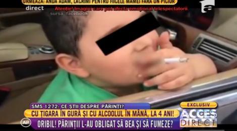 Imagini halucinante! La patru ani, cu ţigara în gură şi amețit de aburii alcoolului! Un tată și-a filmat copilul în aceasta ipostază