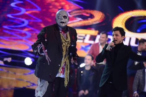 Vedeta care s-a transformat într-un zombi a cerut să plece acasă cu masca pe față!