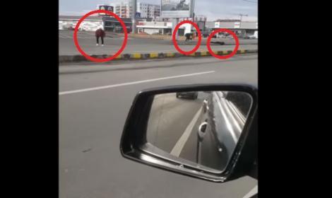 Video! Imaginile care au îngrozit România! Ziua în amiaza mare 3 tineri drogați abia se mai țin pe picioare printre mașini