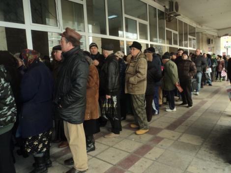Mii de români norocoși vor plăti taxe mai mici la stat! Vezi dacă te încadrezi