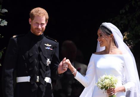 Situație neașteptată! Prinţul Harry şi Meghan Markle amână luna de miere!
