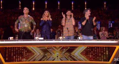 """Românii cuceresc Marea Britanie: Când a început să cânte, Robbie Wiliiams a exclamat: """"Ești bun, ești cel mai bun din lume!"""""""