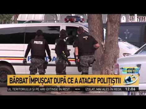Scene de groază pe o stradă din Tecuci. Un bărbat înarmat şi agresiv a fost împuşcat de poliţişti în plină stradă