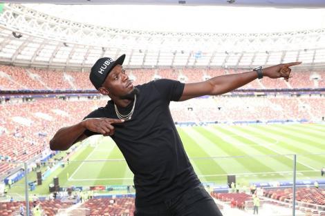 Usain Bolt a testat pista Stadionului Naţional din Tokyo. El va fi prezent la JO, însă ca spectator