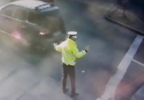 Polițist lovit în plin cu mașina, la Oradea! Camerele de filmare au surprins totul (VIDEO)