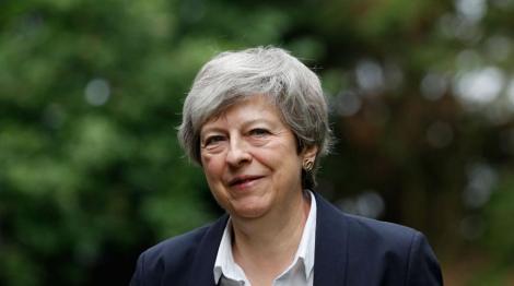 Theresa May se arată mulţumită să îi predea conducerea unui premier hotărât să încheie Brexitul