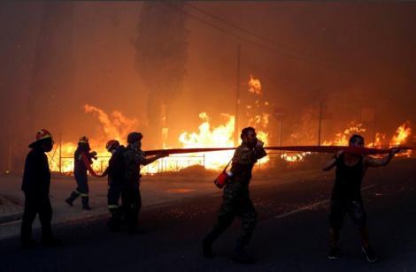 Atenţionare de călătorie emisă de MAE: În mai multe zone din Grecia este risc ridicat de producere a unor incendii de vegetaţie