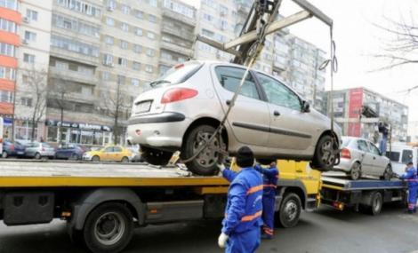 Gata! Începe ridicarea mașinilor parcate neregulamentar în București! Cât vor plăti șoferii ca să le recupereze! Vor scoate BANI MULȚI din buzunare