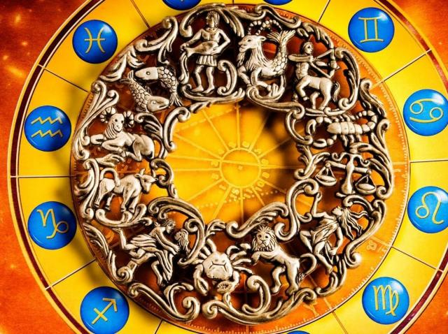 Semnele zodiacului și simbolurile pe care le au in horoscop dispuse circular pe un fundal galben si portocaliu