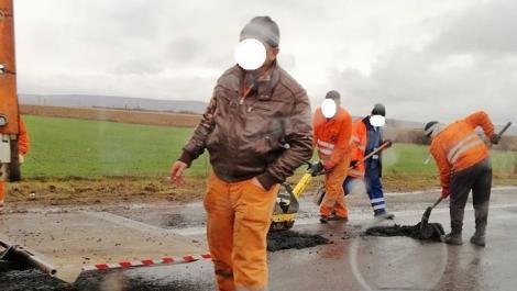 """Petice de asfalt, puse pe ploaie, pe DN1:""""Săptămâna trecută făceau același lucru, în același loc"""""""