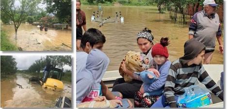 Inundații puternice în vestul țării, în urma ploilor torențiale. Copii și părinți, evacuați de urgență după ce casele le-au fost cuprinse de puhoaie