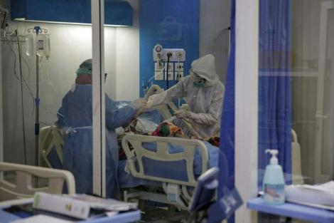 China publică genomul coronavirusului descoperit în focarul recent din Beijing, care ar prezenta asemănări cu tulpina europeană, şi raportează 25 de contaminări noi