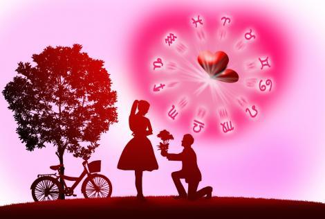 ilustratie cu un cuplu romantic si semnele zodiacale cu o inima in centru