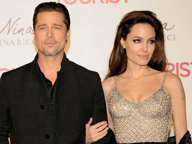 Angelina Jolie si Brad Pitt se tin de brat