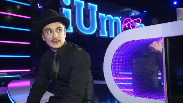 Vlad Drăgulin îmbrăcat într-un costum negru
