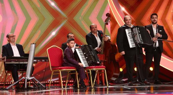 Diego Gruia pe scenă și taraful