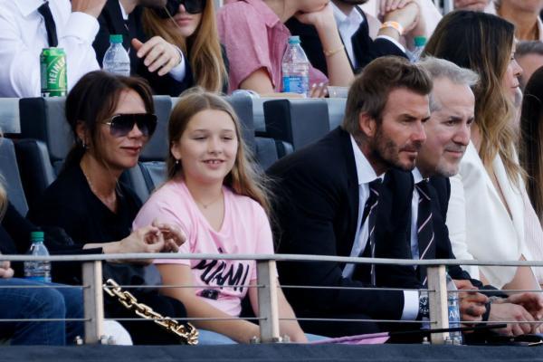 David și Victoria Beckham împreună cu fetița lor, Harper
