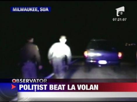 Politist beat la volan