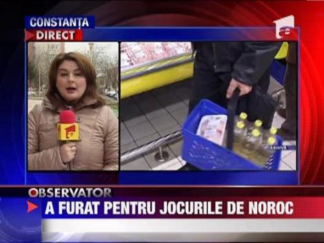 Manager de hypermarket prins la furat