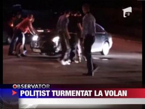 Politist turmentat la volan