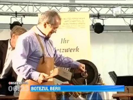 Emil Boc, stropit cu bere din cap pana in picioare