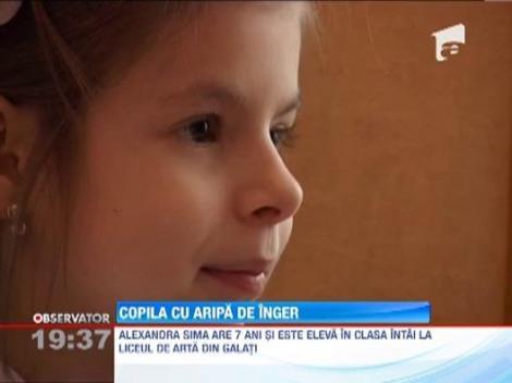 Copila cu aripa de inger: Alexandra Sima are sapte ani si canta la pian cu o singura mana