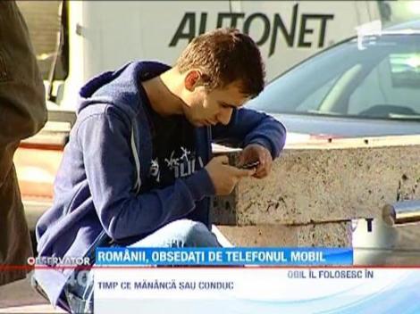 E demonstrat! Romanii sunt obsedati de telefoanele mobile