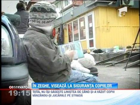 Tatal copiilor din Cluj obligati sa isi vanda jucariile pe strada cere sa isi vada fetita si baiatul