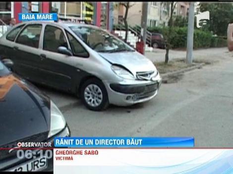 Directorul unui centru comunitar din Baia Mare s-a urcat baut la volan si a lovit trei masini dintr-o parcare