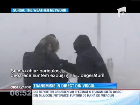 Reporteri luaţi de vânt în timpul unei transmisiuni în direct