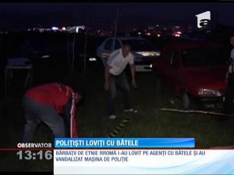 Poliţişti bătuţi cu bâtele de rromi, la Baia Mare