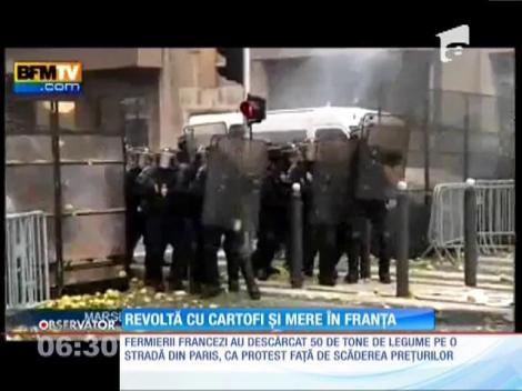 Revoltă cu cartofi și mere în Franța