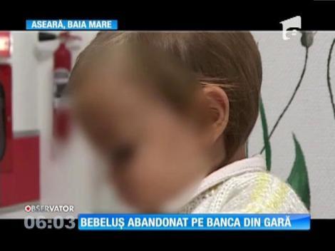 O fetiţă de zece luni, găsită pe o bancă, în gara din Baia Mare