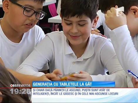 Generația cu tabletele la gât