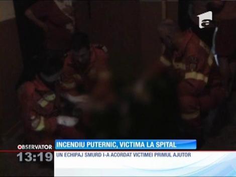 Incendiu puternic, victima la spital