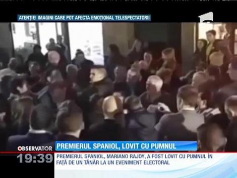 Premierul spaniol, lovit cu pumnul