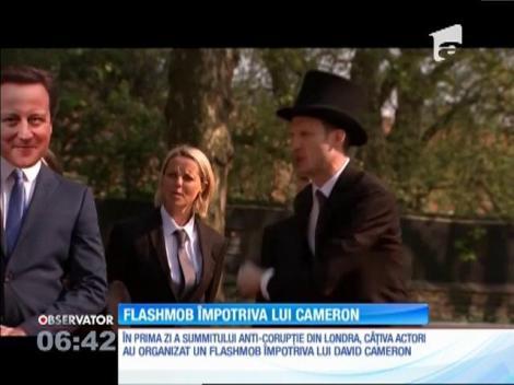 Flashmob împotriva lui David Cameron, chiar în prima zi a summitului anti-corupţie din Londra