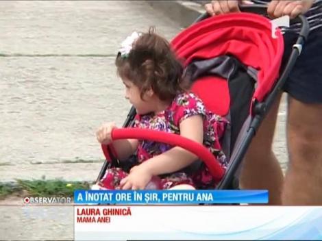 Un sportiv din Petroșani a înotat în râul Jiu pentru o Ana, o fetiță care suferă de o malformaţie a coloanei vertebrale