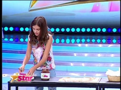 Senzaţional! Anastasia Ivanov a portretizat-o pe Alina, cu ciocolată, pe mai multe felii de pâine prăjită
