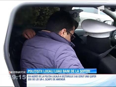 Doi agenţi de la Poliţia Locală Sector 3 cereau bani șoferilor!