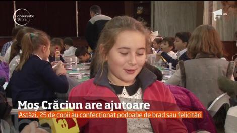 """Mos Craciun are ajutoare in Ploieşti. 25 de puşti meşteresc în """"Atelierele lui Moş Crăciun"""""""