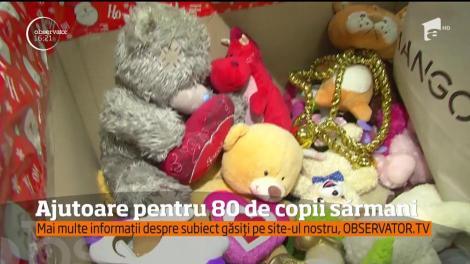 Studenţii de la ASE şi Fundaţia Dan Voiculescu au oferit cadouri pentru 80 de copii sărmani