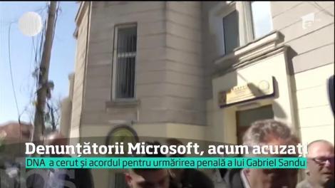Denunţătorii din celebrul dosar Microsoft , Dinu Pescariu şi Claudiu Florică, puşi sub acuzare de procurorii DNA